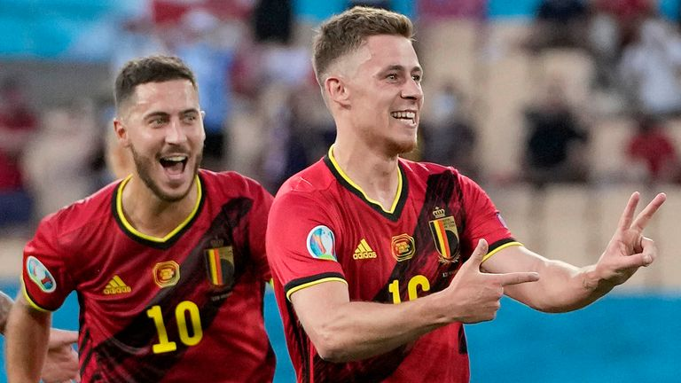 Belgium's Eden Hazard and Thorgan Hazard celebrate after Thorgan scored his side's first goal during the Euro 2020 soccer championship round of 16 match between Belgium and Portugal at the La Cartuja stadium in Seville