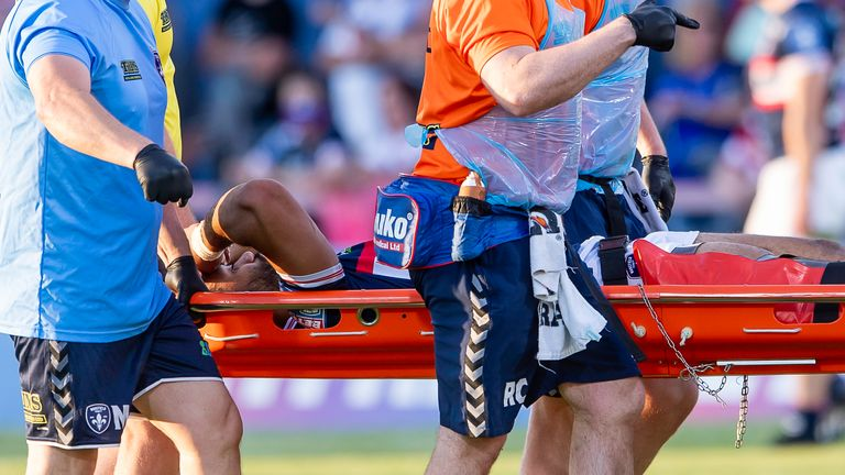 Wakefield's Bill Tupou is stretchered from the field after an injury against Castleford