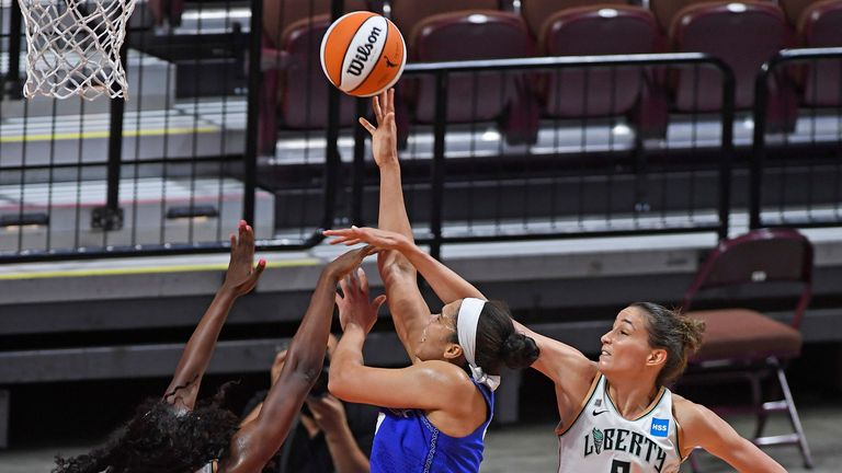 Connecticut Sun forward Brionna Jones is fouled on her shot as New York Liberty forward Michaela Onyenwere and Rebecca Allen defend during a WNBA basketball game
