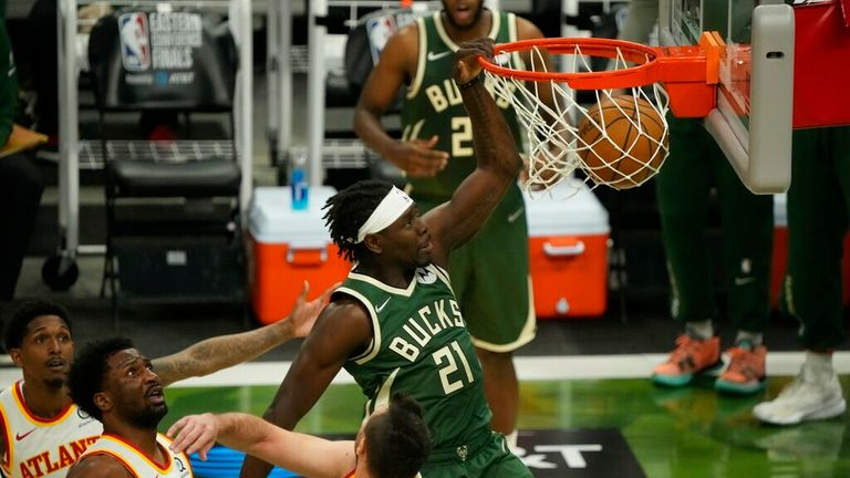 Milwaukee Bucks' Jrue Holiday dunks during the first half of Game 1 of the NBA Eastern Conference basketball finals game against the Atlanta Hawks Wednesday, June 23, 2021, in Milwaukee. (AP Photo/Morry Gash)