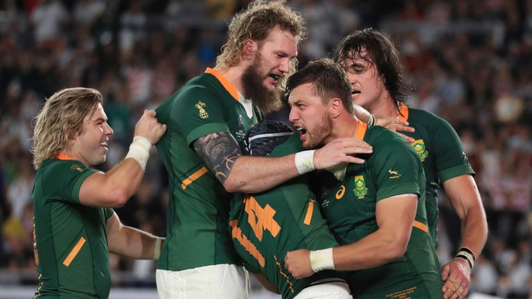 Cheslin Kolbe is swarmed by team-mates after scoring a try in the World Cup final