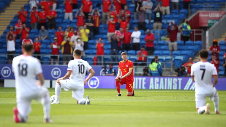 Wales v Albania - International Friendly - Cardiff City Stadium Wales' Chris Mepham takes a knee prior to the international friendly match at Cardiff City Stadium, Wales. Picture date: Saturday June 5, 2021.
