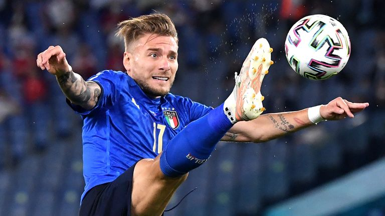 Ciro Immobile stretches to control the ball against Switzerland