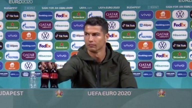 Cristiano Ronaldo moves  Coca-Cola bottles
