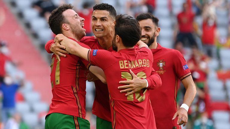 Portugal's Cristiano Ronaldo celebrates with Diogo Jota and Bernardo Silva after scoring against Germany