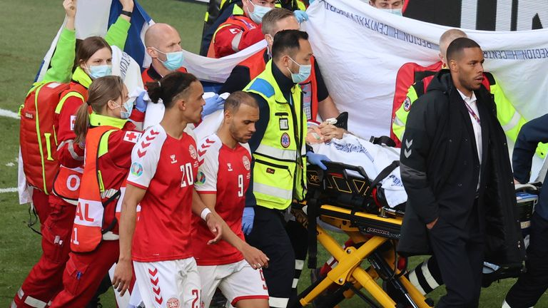 A protective curtain was raised as Eriksen received treatment