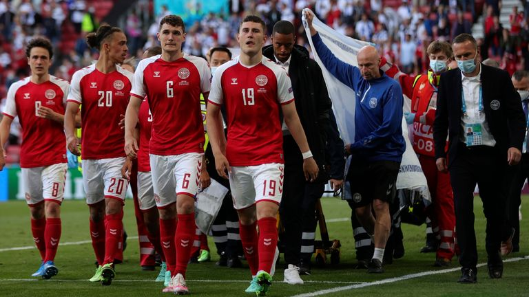 Paramedics using a stretcher to take out of the pitch Denmark's Christian Eriksen after he collapsed during the Euro 2020 soccer championship group B match between Denmark and Finland at Parken stadium in Copenhagen, Denmark, Saturday, June 12, 2021