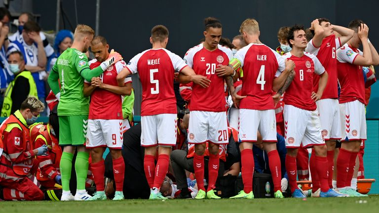 Denmark's players were visibly distressed after Eriksen collapsed at the Parken Stadium
