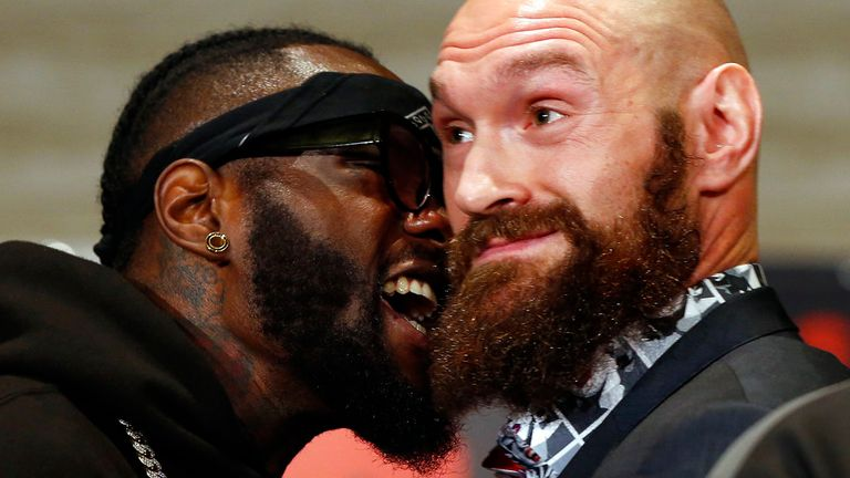 Boxers Deontay Wilder, left, and Tyson Fury exchange words as they face each other at a news conference in Los Angeles Wednesday, Nov. 28, 2018.ahead of their heavyweight world championship boxing match in Los Angeles on Dec. 1, at Staples Center in Los Angeles. (AP Photo/Damian Dovarganes)