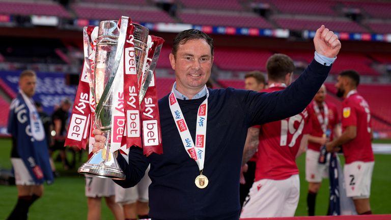 PA - Derek Adams led Morecambe to promotion