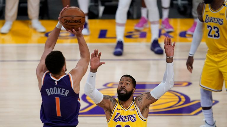 Phoenix Suns guard Devin Booker shoots against Los Angeles Lakers forward Markieff Morris during Game 6 of an NBA basketball first-round playoff series