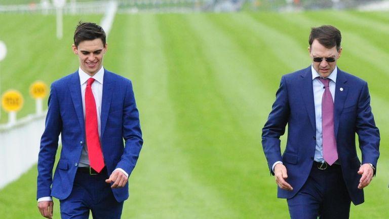Donnacha, left, walks the track with father Aidan O'Brien