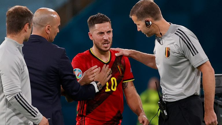 Eden Hazard was treated by Belgium's medical team after pulling up in the latter stages of their win over Portugal