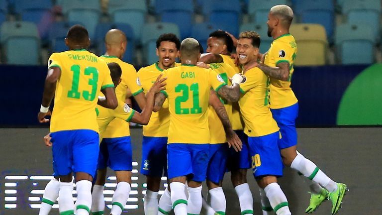 Eder Militao of Brazil celebrates with his team mates after scoring