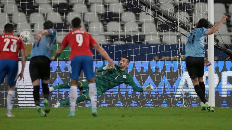 Uruguay's Edinson Cavani, right, scores from the penalty spot against Paraguay during a Copa America soccer match at Nilton Santos stadium in Rio de Janeiro, Brazil, Monday, June 28, 2021. (AP Photo/Ricardo Mazalan)