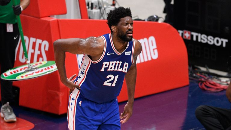 Philadelphia 76ers center Joel Embiid reacts after he fell onto the court during the first half of Game 4 in a first-round NBA basketball playoff series against the Washington Wizards