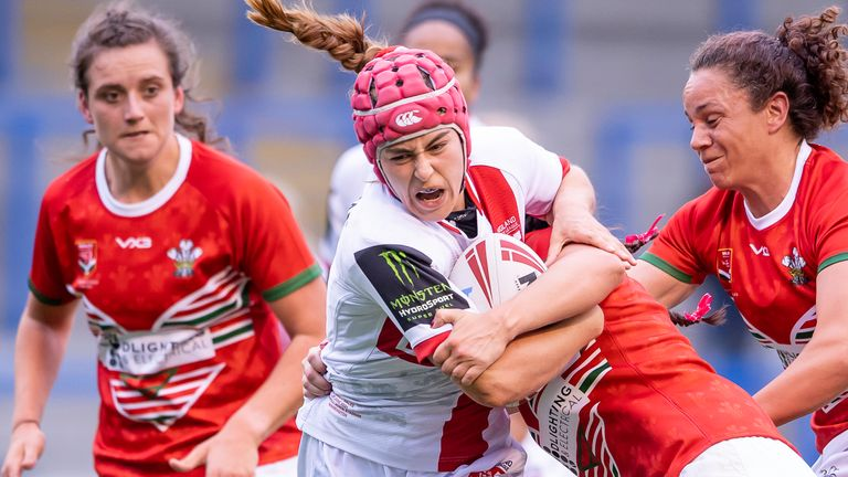 England's Emily Rudge fights through the Welsh tackles.