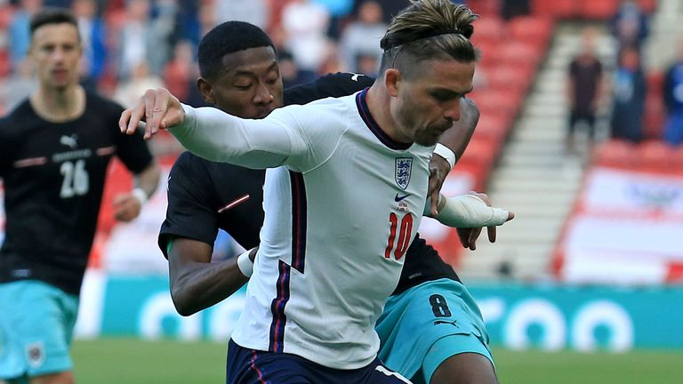 England's Jack Grealish holds off Austria's David Alaba during the international friendly soccer match between England and Austria at the Riverside stadium in Middlesbrough, England, Wednesday June 2, 2021. (Lindsey Parnaby, Pool via AP)