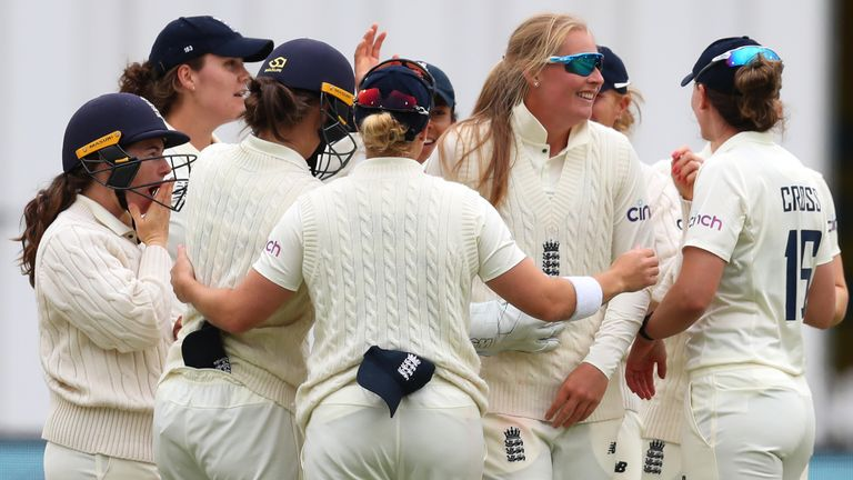 Sophie Ecclestone of England celebrates with team-mates after picking up the wicket of India's Deepti Sharma on Day four