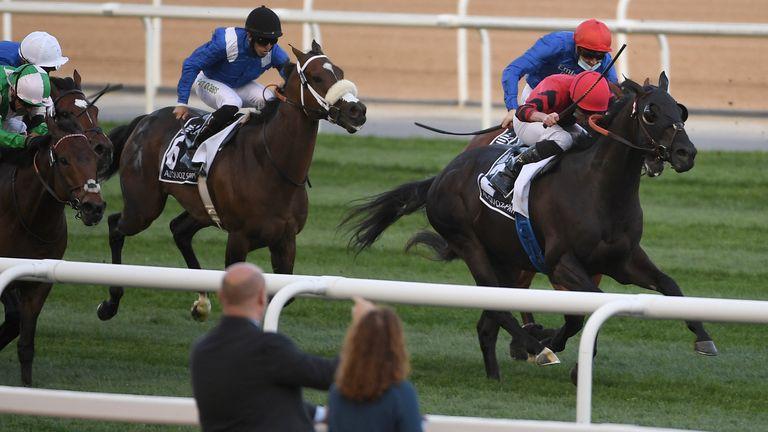Extravagant Kid with jockey Ryan Moore wins the Group One Al Quoz Sprint in Dubai