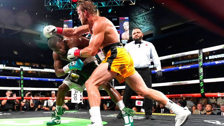 Floyd Mayweather, left, and Logan Paul fight during an exhibition boxing match at Hard Rock Stadium, Sunday, June 6, 2021, in Miami Gardens, Fla. (AP Photo/Lynne Sladky)