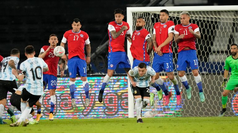 Lionel Messi scores a goal against Chile in the Copa America