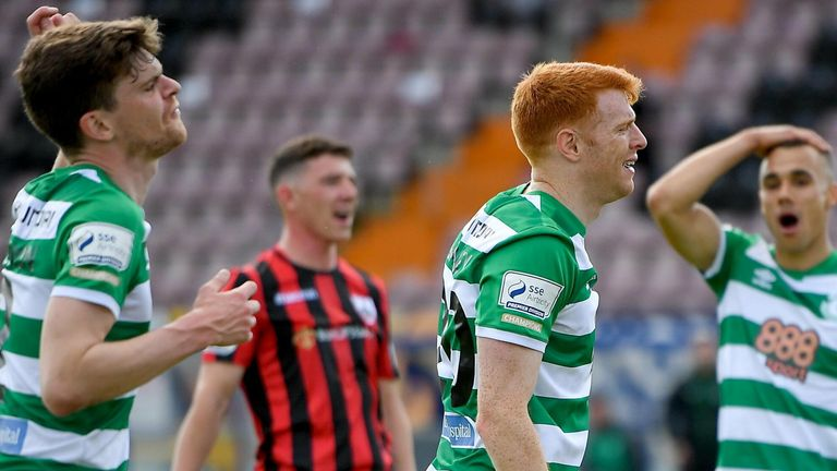 Rory Gaffney of Shamrock Rovers, centre, reacts after seeing his goal ruled out for a handball, as team-mates Sean Gannon, left, and Graham Burke react to the decision