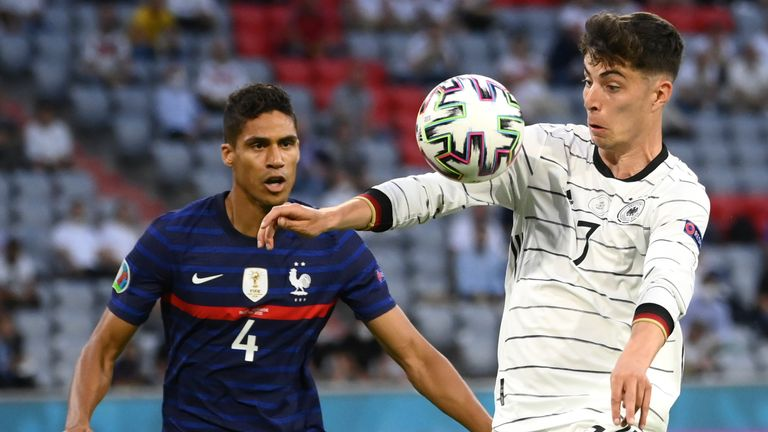 France's Raphael Varane challenges Germany's Kai Havertz