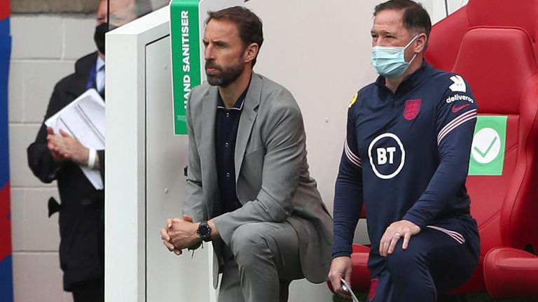 England manager Gareth Southgate (left) takes a knee (AP)