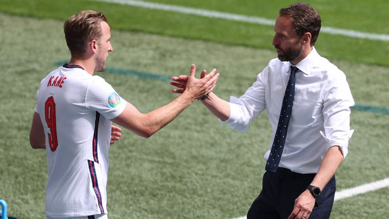 Gareth Southgate and Harry Kane celebrate after England's win over Croatia
