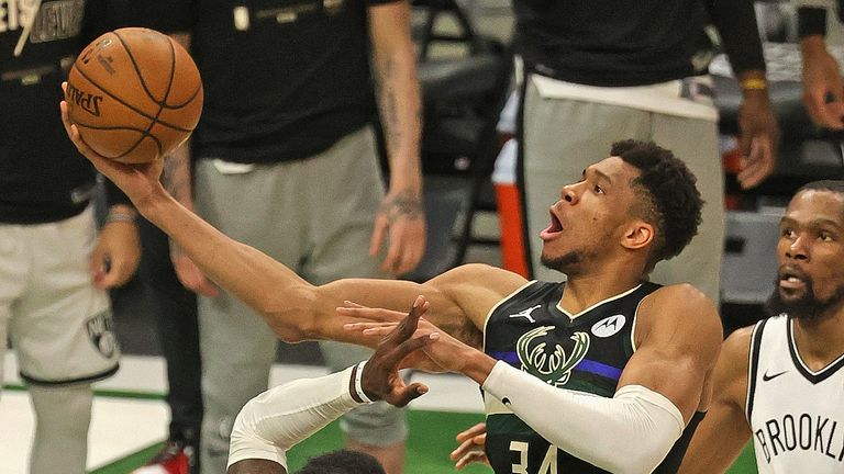 MILWAUKEE, WISCONSIN - JUNE 17: Giannis Antetokounmpo #34 of the Milwaukee Bucks shoots over Jeff Green #8 of the Brooklyn Nets at Fiserv Forum on June 17, 2021 in Milwaukee, Wisconsin. The Bucks defeated the Nets 104-89. NOTE TO USER: User expressly acknowledges and agrees that, by downloading and or using this photograph, User is consenting to the terms and conditions of the Getty Images License Agreement. (Photo by Jonathan Daniel/Getty Images)