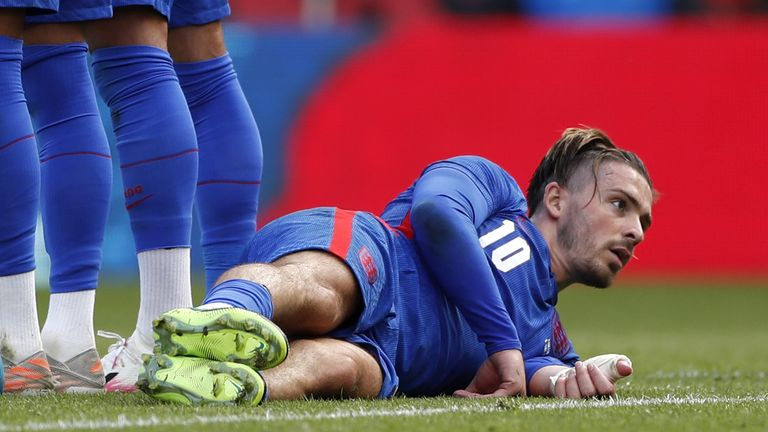 Jack Grealish lays down behind the England wall against Romania