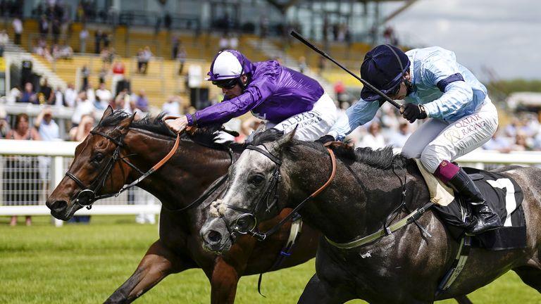 Great Max, in Amo Racing's purple colours, gets past Andrew Balding's Harrow to win at Newbury