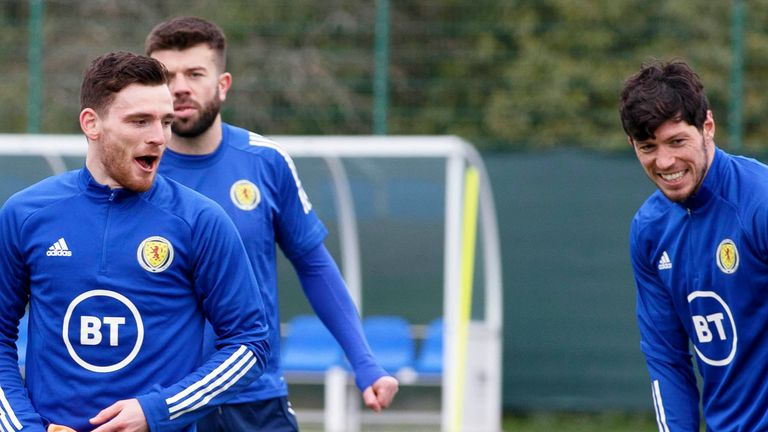 Scott McKenna (right) is backed to start alongside Grant Hanley and Andy Robertson