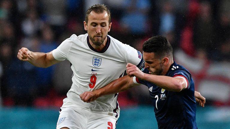 John McGinn and Harry Kane challenge for the ball during England vs Scotland