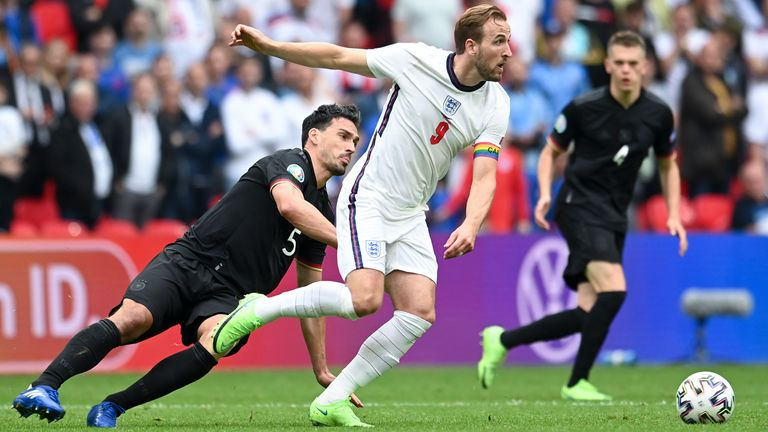 England's Harry Kane, right, is challenged by Germany's Mats Hummels during the Euro 2020 soccer championship round of 16 match between England and Germany, at Wembley stadium in London, Tuesday, June 29, 2021. (Andy Rain, Pool via AP)