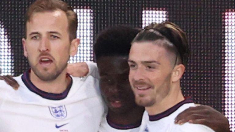Jack Grealish (right) celebrates with England teammates Harry Kane (left) and Bukayo Saka (Getty)