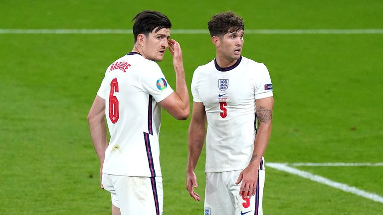 England's Harry Maguire (left) and John Stones in discussion during the UEFA Euro 2020 Group D match at Wembley Stadium, London