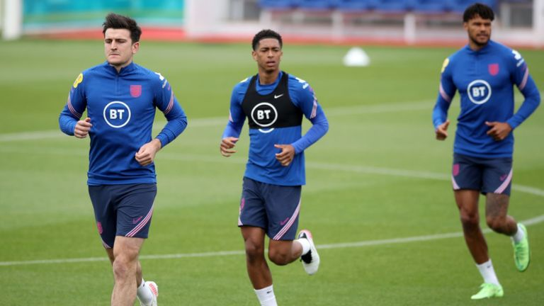 Harry Maguire with Jude Bellingham during England training on Thursday (PA)