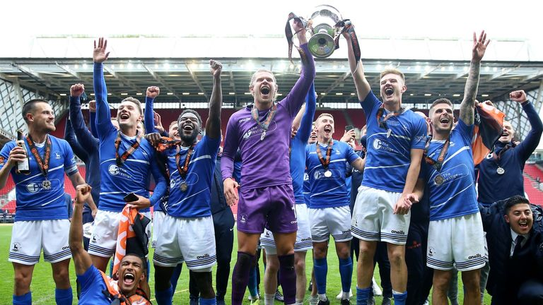Hartlepool lift the National League play-off trophy (PA)