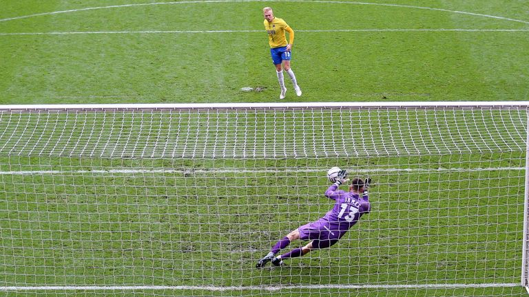 Hartlepool goalkeeper Brad James saves Matt Buse's penalty to seal National League play-off final victory (PA)