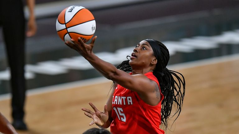 Atlanta defender Tiffany Hayes drives into the basket during a WNBA game against the Dallas Wings