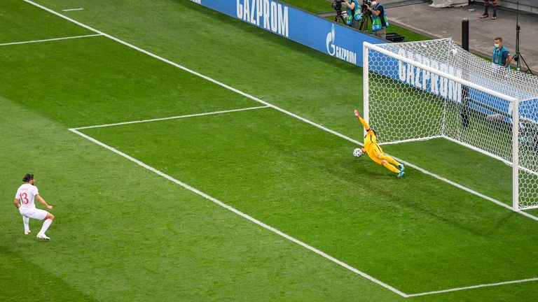 France's goalkeeper Hugo Lloris saves a penalty taken by Switzerland's Ricardo Rodriguez, left, during the Euro 2020 soccer championship round of 16 match between France and Switzerland at National Arena stadium, Bucharest