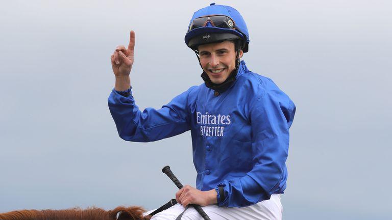 Jockey William Buick celebrates after winning the Dubai Duty Free Irish Derby on Hurricane Lane