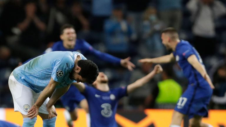 Manchester City's Ilkay Gundogan reactes as Chelsea players celebrate end of the Champions League final soccer match between Manchester City and Chelsea at the Dragao Stadium in Porto, Portugal, Saturday, May 29, 2021. (AP Photo/Manu Fernandez, Pool)