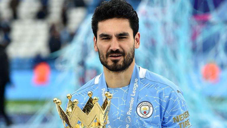 Manchester City's Ilkay Gundogan celebrates with the trophy after the final whistle in the Premier League match at the Etihad Stadium, Manchester. Picture date: Sunday May 23, 2021.