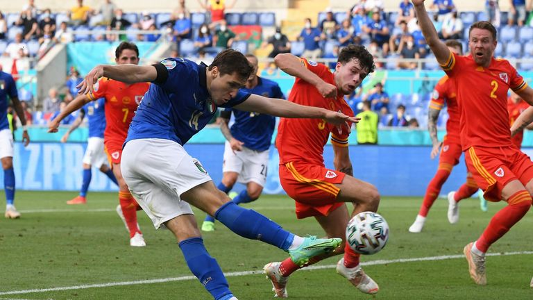 Italy's Federico Chiesa attempts a shot against Wales