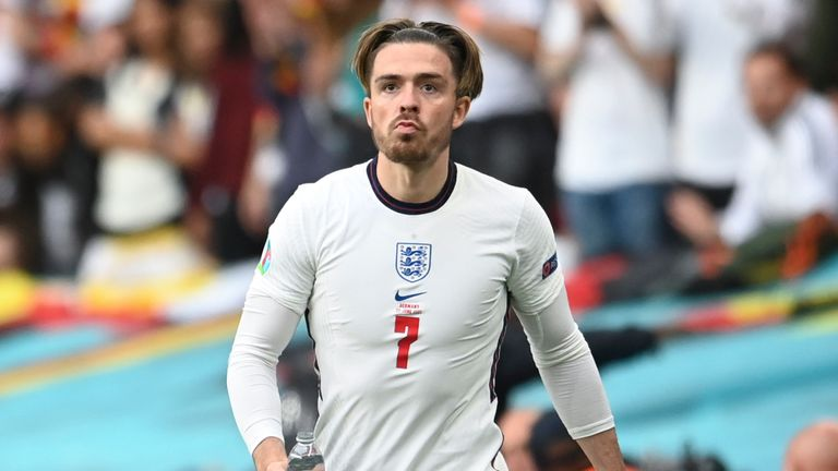 England's Jack Grealish stands near the pitch as Germany manager Joachim Loew is seen left in the round of 16 of the Euro 2020 Football Championship between England and Germany at Wembley Stadium in London, Tuesday June 29, 2021 (Andy Rain, Pool via AP)
