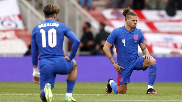 England's Jack Grealish and Kalvin Phillips take a knee before their warm-up fixture against Romania