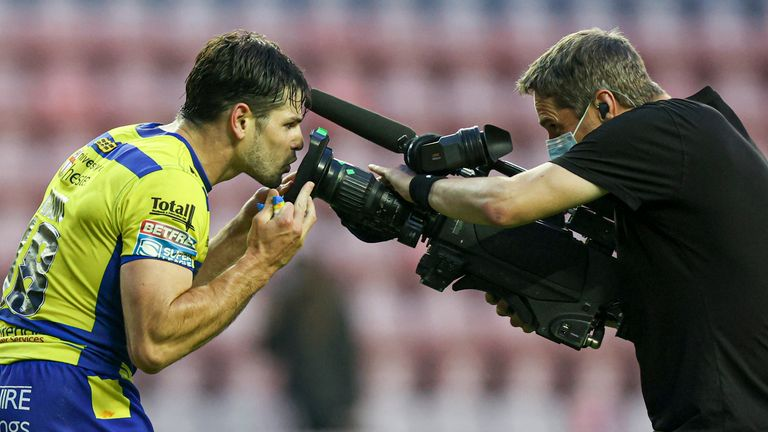 Jake Mamo celebrates scoring his 3rd and hat trick try by kissing the tv camera